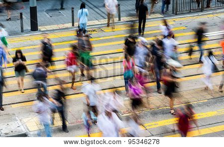 Rush Hour with crowded people crossing the road