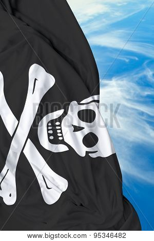 Pirate waving flag on a beautiful day