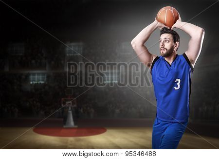 Basketball Player on a blue uniform in basketball court