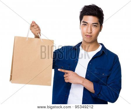 Asian mixed Indian man finger point to shopping bag
