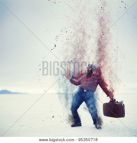 hipster with beard and suitcase turning into dust on the salt flats with retro filter