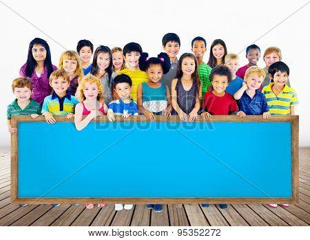 Multi-Ethnic Group of Children Holding Empty Billboard Concept