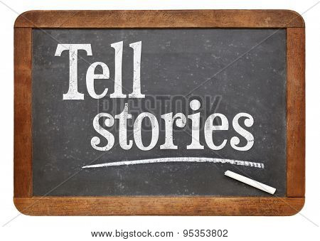 Tell stories advice - text in white chalk on a vintage slate blackboard