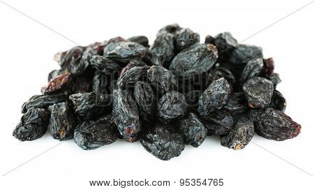 Pile of black dried sultana isolated on white