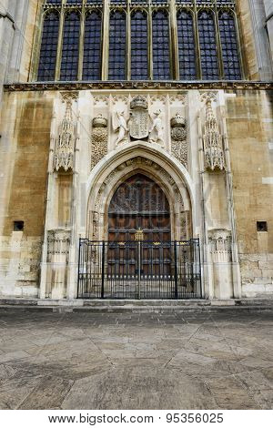 CAMBRIDGE, ENGLAND - MAY 13: Architectural Detail of Front Entrance with Closed Wooden Doors of Kings College Chapel, University of Cambridge, England on May 13, 2015