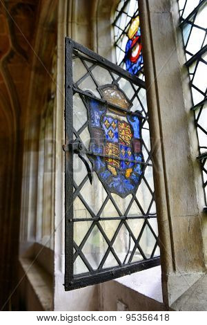 CAMBRIDGE, ENGLAND - MAY 13: Architectural Interior Close Up of Open Window Featuring Colorful Stained Glass Coat of Arms in Kings College Building, University of Cambridge, England on May 13, 2015