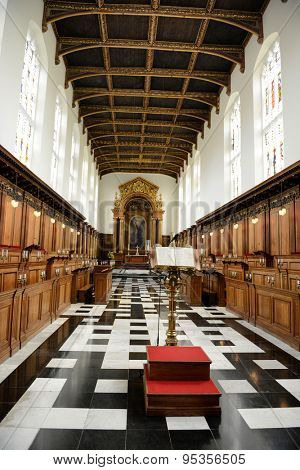 CAMBRIDGE, ENGLAND - MAY 13: Interior of Trinity College Chapel Looking Towards Baldacchino Altar with Golden Eagle Lectern in Foreground and Stalls, Cambridge University, England on May 13, 2015