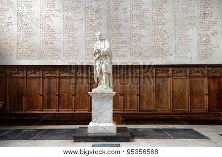 CAMBRIDGE, ENGLAND - MAY 13: Statue of Isaac Newton in front of World War II Memorial Inside Trinity College Chapel, Cambridge University, England on May 13, 2015