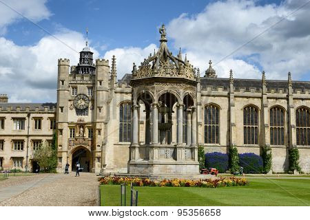 CAMBRIDGE, ENGLAND - MAY 13: Landmarks of the Great Court, Trinity College,Cambridge University, Cambridge, UK, with the ornate central stone fountain, Kings Gate and Chapel on May 13, 2015