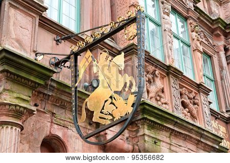 HEIDELBERG, GERMANY - APRIL 26: Detail of Sign Featuring Golden Rider on Horseback on Exterior of Historic Hotel Zum Ritter in Heidelberg, Baden-Wurttemberg, Germany on April 26, 2015