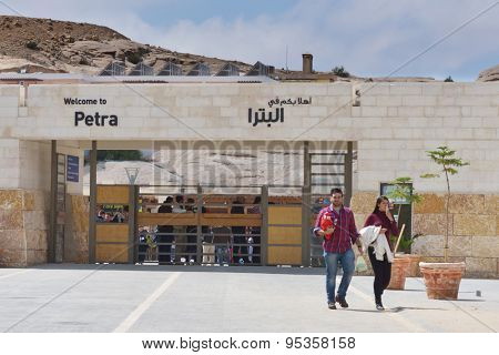 PETRA, JORDAN - MARCH 15, 2014: Tourists near the main entrance to Petra. Since 1985, Petra is listed as UNESCO World Heritage site