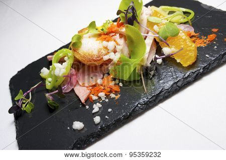 Chicken salad with scallop and seasonal fruit.