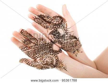 Image of henna on female hands isolated on white