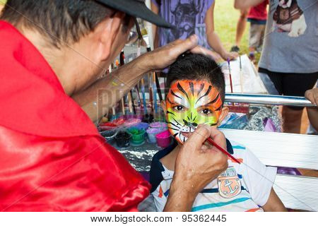 SAO PAOLO, BRAZIL - APRIL 21, 2015: Boy with face paintig on April 21, 2015  in Ibirapuera Park, Sao Paolo, Brazi.  Ibirapuera Park is the largest park in the city gathering over 22 million sq. ft.f