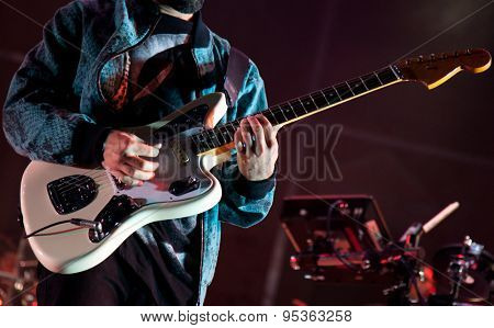 BONTIDA, ROMANIA - JUNE 28, 2015: Guitarist on stage during a live concert at Electric Castle festival, one of the biggest music festivals in Romania.