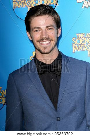 BURBANK - JUNE 25: Grant Gustin arrives at the 41st Annual Saturn Awards on Thursday, June 25, 2015 at the Castaway Restaurant in Burbank, CA.