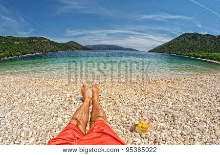 Paradise Relax with pint of beer at Antisamos Beach in Kefalonia, Greece