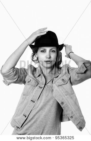 Young woman in a denim jacket and a black hat. Black and white portrait