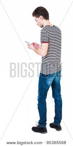 back view of man in suit  talking on mobile phone.    rear view people collection. Isolated over white background. backside view of person. The guy in the striped shirt digging in...