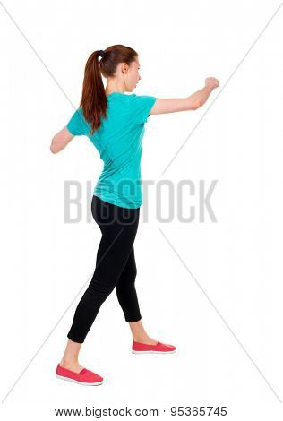 skinny woman funny fights waving his arms and legs. Rear view people collection.  backside view of person.  Isolated over white background. Sportswoman in tights coached punch.