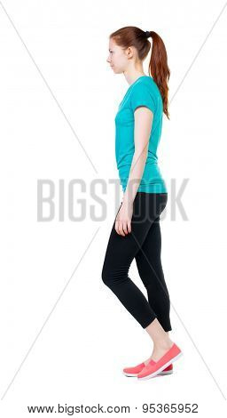 side view of walking  woman in sports tights. beautiful girl in motion.  backside view of person.  Rear view people collection. Isolated over white background. Sports girl goes to the left.