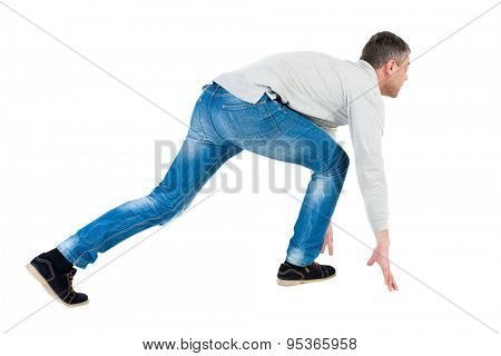 side view man start position.  Rear view people collection.  backside view of person.  Isolated over white background. Man in fashionable clothes to prepare for the sprint.