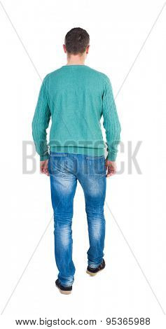 Back view of going  handsome man in jeans and a shirt.  walking young guy . Rear view people collection.  backside view person.  Isolated over white background. guy in green jacket slowly goes away