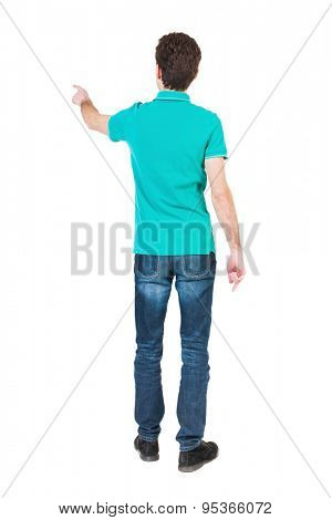 Back view pointing young men in  shirt and jeans. Young guy  gesture. Rear view people collection. backside view person. Isolated over white background. guy in a stylish T-shirt shows the left hand