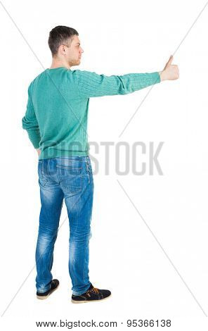 Back view of  man in shirt shows thumbs up.   Rear view people collection.  backside view of person. Isolated over white background.  guy in the green jacket is raising his hand in a gesture thumb up