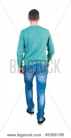 Back view of going  handsome man in jeans and a shirt.  walking young guy . Rear view people collection.  backside view of person.  Isolated over white background. The guy in the green jacket went off