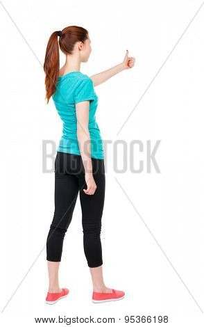 Back view of  woman thumbs up. Rear view people collection. backside view of person. Isolated over white background. Sports girl is holding up his left hand with a thumbs up gesture.