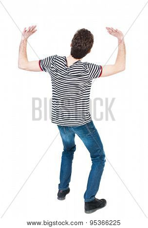 back view. man protects hands from what is falling from above. Man holding a heavy load Rear view people collection. Isolated over white background. guy in striped shirt holds hands something heavy