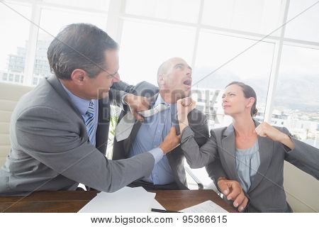 Business partners fighting together in an office