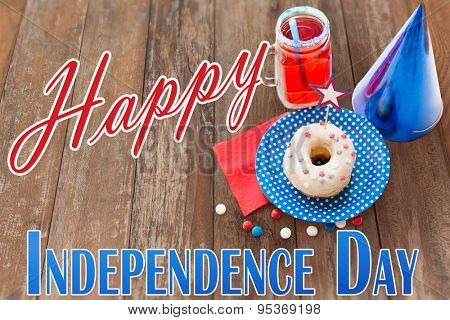 happy american independence day, celebration, patriotism and holidays concept - close up of donut decorated with star, juice in mason jar mug and candies at 4th july party from top