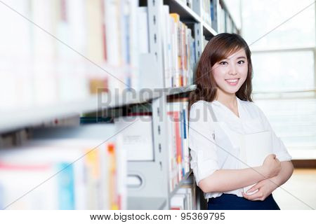 asian beautiful female student portrait in library