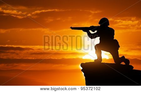 Silhouette of soldier on the edge. Element of design.