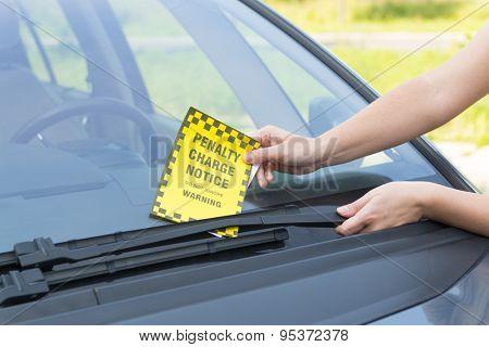 Parking ticket placed under windshield wiper
