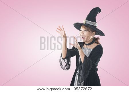 Asian witch woman using magic, closeup portrait with copyspace.