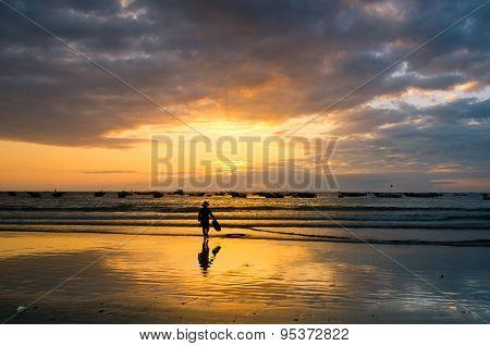 Fishermans are working in sunrise at My Khe beach, Danang, Vietnam