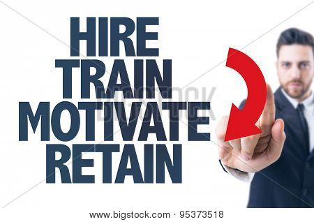 Business man pointing the text: Hire Train Motivate Retain