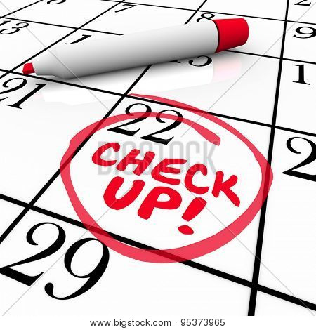 Check Up words on a calender written by red pen or marker to remind you of an exam, test or medical doctor appointment on your schedule