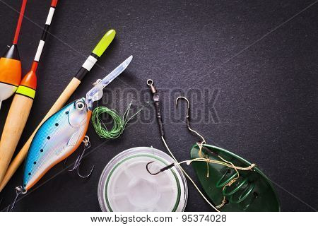 Fishing tackle on dark background