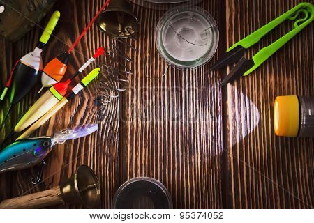 Fishing tackle on wooden background