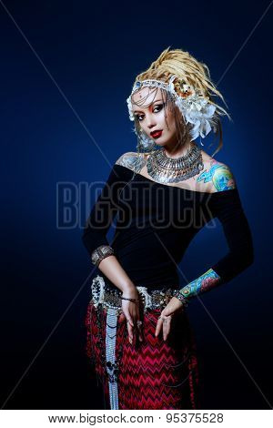 Studio shot of a beautiful traditional female dancer. Ethnic dance. Belly dancing. Tribal dancing.