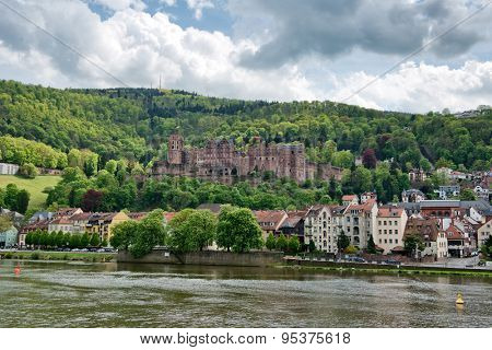 View of Heidelberg Castle and Town on the Banks of Neckar River, Surrounded by Lush Forested Hillsides, Heidelberg, Baden-Wurttemberg, Germany