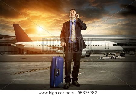 Businessman with baggage in airport