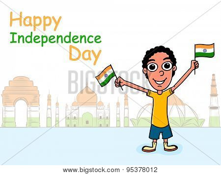 Cute boy holding Indian national flag and celebrating Happy Independence Day on famous historical monuments background.