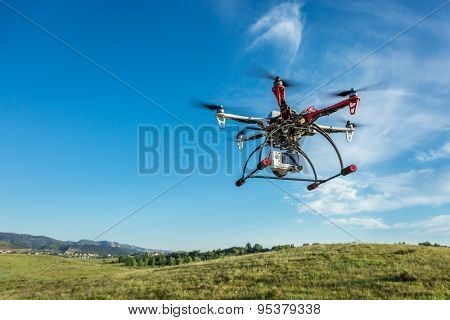 FORT COLLINS, CO, USA, June 28, 2015:  DJI  F550 Flame Wheel  hexacopter drone with Sony A6000 camera flying over foothills prairie,