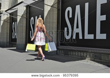 Girl shopping at the sale