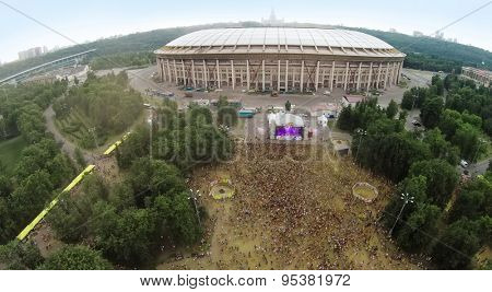RUSSIA, MOSCOW - JUN 7, 2014: Aerial view of Luzhniki stadium at festival of colours Holi. Photo with noise from action camera
